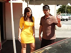 Milf in a tight yellow dress goes tire shopping