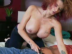 Joslyn sucking and rubbing cock on the bed