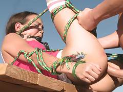 Teen is all tied up and sadisticly fucked outdoors