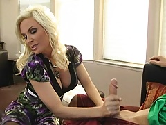 Busty blonde milf sucks on a large cock