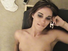 Dakota relaxes with her legs open and while on her phone