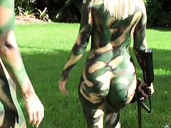 Hot naked chicks in military body art playing paintball