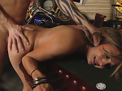 Lexi holding on to the poker table while getting fucked