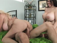 Two sluts with super huge tits and one lucky cock