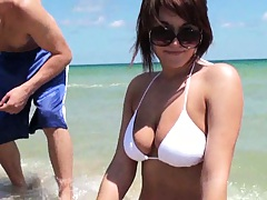 Busty chick showing real natural tits on the beach