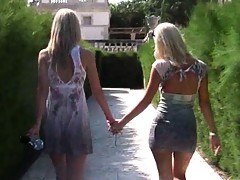 Molly and her friend walk around gardens