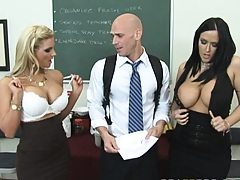Two busty teachers show their tits to their student