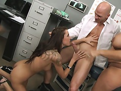 Two chicks in the doctors office working on orgasm