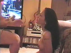 Asian slut fucked in the living room with the tv on