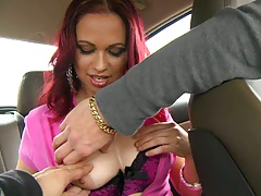 Latina taking a ride in the back seat