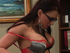 Eva Angelina wearing her bra and panties in the office holds man cock over pants