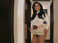 Brunette milf Kiara Marie rolls up her dress