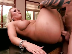 Milf gets her ass sideways penetrated on table