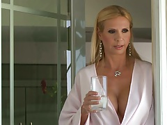 Experienced milf mature Brooke Tyler wearing a sexy robe going down