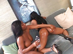 Ebony oil lesbian and dildo fucking each other