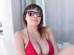 Mali Luna wearing a sexy red bikini over big tits