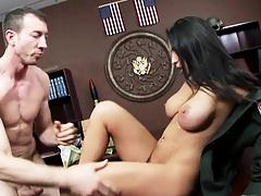 Busty slut gets fucked on the wooden office desk