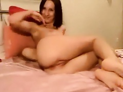 Babe is doing a webcam show with shaved pussy
