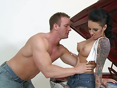 Big tits Christy Mack undressing while fixing a car