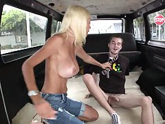 Big tits Puma Swede reaches around cock for blow