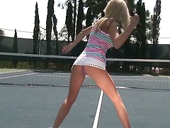 Sporty girl in a tight short skirt Kaylee Hilton playing some tennis outdoors