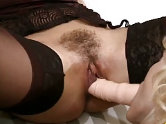 Sucking a double sided dildo in lesbian sex with Missy