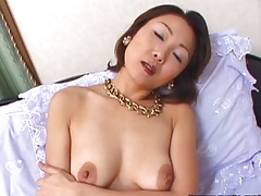 Asian natural tits milf in stockings gets vibrator in her hairy pussy