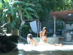 Spying Lexi and Eve tanning nude