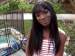 Hot black teen Ana Foxxx outdoors by the pool