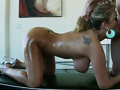Big tits Jessica Moore oiled up sucking some dick