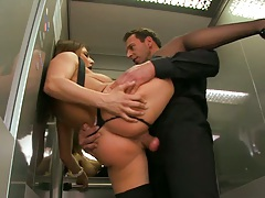 Big tits Roberta sits on cock in public elevator