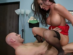 Richelle sits on her boss on the table