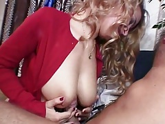 Milf Isabelle places cock between two natural big tits and sucks shaft