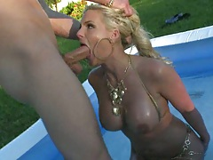 Phoenix Marie sits in water and sucks dick