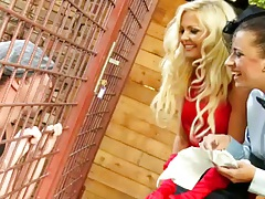 Kirsten Plant and Jenna Lovely chatting with some dude in a cage outdoors
