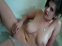 Big amateur boobs in the tub and a blowjob
