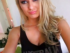 Blonde Natalia Starr taking off her tight clothes with hotpants