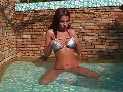 Teen Angelique in the pool taking off bikini