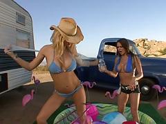 Bikini lesbian milfs Holly Sampson and Rachel Roxxx outdoors